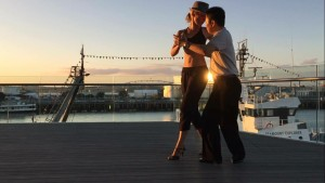 The Deck Practica, Alex and Sonny dancing at sunset on the right side